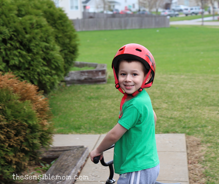 David riding his bike outside - staying active and wearing his favorite Luigi shirt!